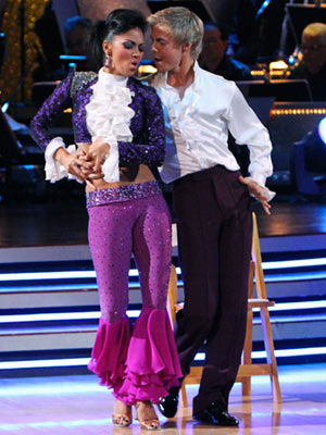 Dancing With the Stars | NICOLE SCHERZINGER AND DEREK HOUGH: CHA CHA CHA Purple reigned during ''Kiss,'' the couple's tribute to Prince. Why wear one raspberry beret on your head…