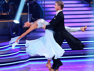 Dancing With the Stars | NICOLE SCHERZINGER AND DEREK HOUGH: WALTZ Standard Disney princess gown for Nicole. The floral Immunity Idols awarded to her and Derek after the dance really…