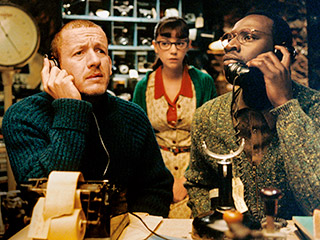 Micmacs | LISTEN CLOSELY Dany Boon, Marie-Julie Baup, and Omar Sy share a phone line in Micmacs