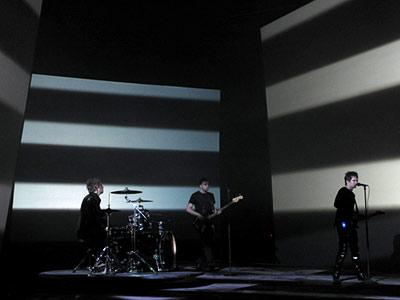 Drummer Dominic Howard, bassist Christopher Wolstenholme, and Bellamy