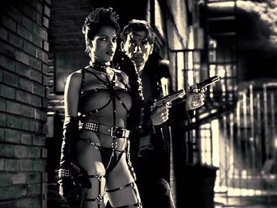 ROSARIO DAWSON as Gail SIN CITY Ultimate Hottie Moment: Her dominatrix-prostitute character stands firmly by her man's side...while looking mighty fine in that barely there…