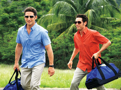In season 2 of USA's Hamptons-set Royal Pains , debuting June 3, concierge doctor Hank (Mark Feuerstein, left) digs deeper into the mystery illness plaguing…