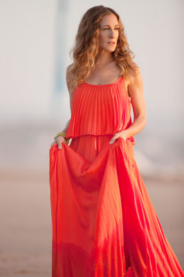 Sex and the City 2, Sarah Jessica Parker | In Sex and the City 2 , Carrie wears five looks by design house Halston, but this vivid orange maxi dress is the clear standout…