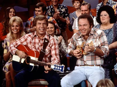 HEE HAW PREMIERED June 15, 1969 THE SCOOP Back in the days when there were rabbit ears in practically every living room — and thus…