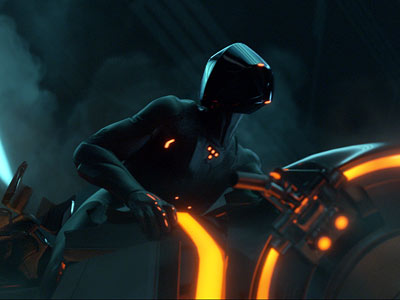 Tron | A digital-era remodel of an analog-era vision of the future. It's got The Dude, and it's got light cycles, and it's got Olivia Wilde...but does…