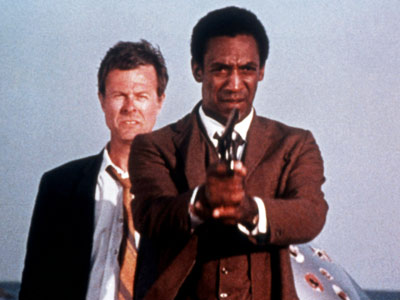 Bill Cosby and Robert Culp had been a pioneering interracial pair in the 1960s series I Spy , but the actors' reunion in this grimy,…