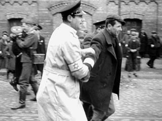 A Film Unfinished | IN THE GHETTO A Nazi soldier and Warsaw residents in A Film Unfinished