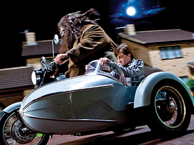 Harry Potter and the Deathly Hallows - Part 1 | Robbie Coltrane reprises his role as the hirsute giant Hagrid; here, he and Harry race down Privet Drive.