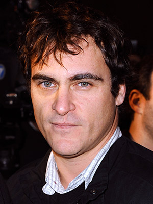 Joaquin Phoenix | What better way to cap off the mysterious, hoax-y seeming ''documentary'' phase of his life than with a hosting gig? Oh, with a shower and…