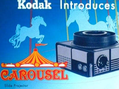 K: KODAK CAROUSEL The best of Don's grandiloquent monologues was his pitch for the new slide wheel.