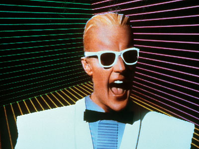 Max Headroom | MAX HEADROOM: THE COMPLETE SERIES The sci-fi TV show built around the sarcastic, stuttering digital icon of the '80s is now on DVD. Technol­ogy may…