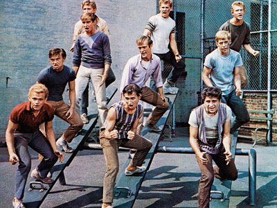 West Side Story | WEST SIDE STORY With all its finger snapping and dancing, this nearly nine-minute-long scene was a perfect introduction to the two groups of fleet-footed street…