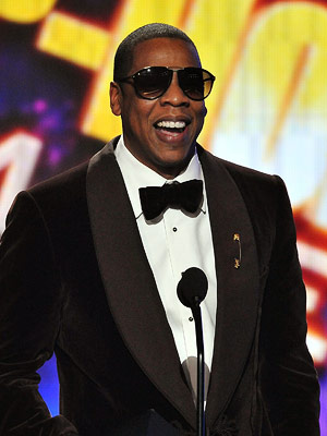 Jay-Z   WHO WE'D LIKE TO SEE HOST: JAY-Z FOR THE GRAMMYS Few people in the music industry are cooler or more beloved than Jay-Z. While he…