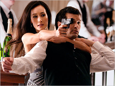 WHICH WAY TO THE GUN SHOW? Maggie Q's Nikita has everything under control.