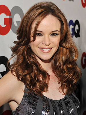 Danielle Panabaker | Her book description: ''A fox-faced girl with sleek red hair from District 5.'' Our pick: Danielle Panabaker ( Shark , Friday the 13th )
