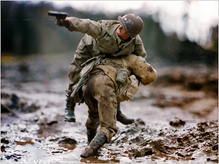 TOY SOLDIER A medic rescues a wounded major after an ambush by the SS in Marwencol