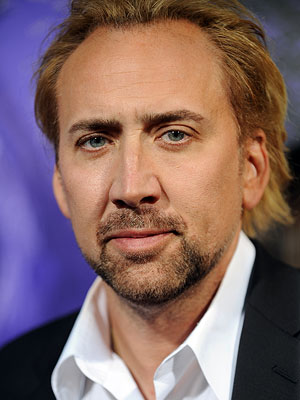 Nicolas Cage | His book description: ''Caesar Flickerman, the man who has hosted the interviews for more than 40 years, bounces onto the stage. It's a little scary…