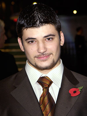 His book description: ''A monstrous boy who lunges forward to volunteer from District 2.'' Our pick: Stanislav Ianevski (Viktor Krum in Harry Potter )