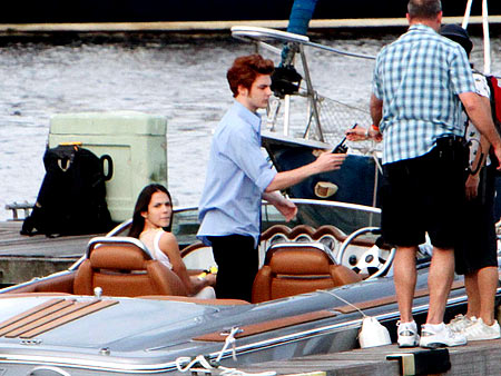 Kristen Stewart, Robert Pattinson | The stand-ins earn their check. We hope he gets a bonus for that hair.