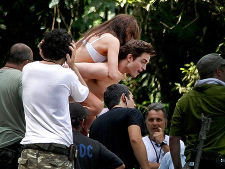 Kristen Stewart, Robert Pattinson | Pattinson gives Stewart a ride on the set of The Twilight Saga: Breaking Dawn in Brazil.