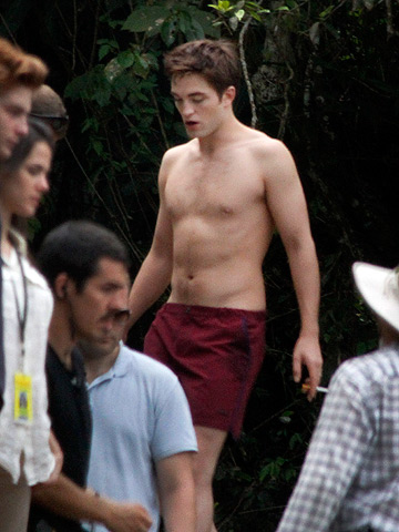Robert Pattinson | Pattinson bares his abs on the set of The Twilight Saga: Breaking Dawn .