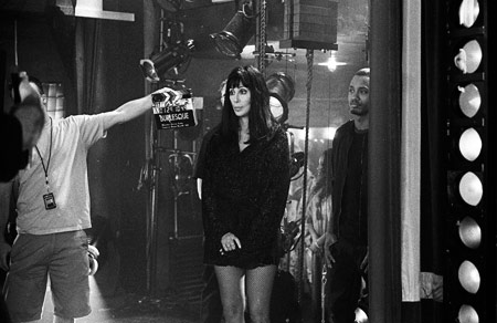 Cher, Burlesque | Cher waiting to film a scene. ''It's a contemporary movie but in terms of the old-style musicals that were just two tons of popcorn fun,…