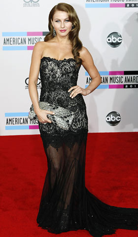 Julianne Hough, American Music Awards 2010 | The Burlesque actress and former Dancing With the Stars pro showed off perfectly coiffed retro curls with an ornate lace Marchesa dress — and botched…