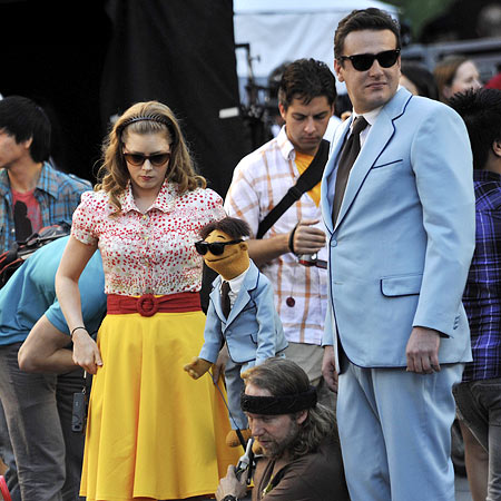 Amy Adams, Jason Segel | Amy Adams and Jason Segel (and a mini-me muppet) filming a scene from the Muppets movie in Hollywood.