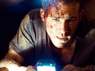 Buried, Ryan Reynolds | IN A TIGHT SPOT Ryan Reynolds tries to escape in Buried