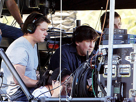Matt Damon with director Cameron Crowe on the set of We Bought a Zoo .
