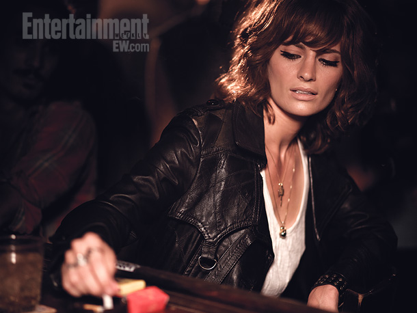 Sporting a voluminous late-'70s hairdo, edgy makeup, a ''badass'' attitude, and no bra, Castle 's Stana Katic says she was excited to channel her inner…
