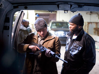 BROTHERS IN ARMS Val Kilmer and Curtis ''50 Cent'' Jackson demonstrate why the movie is called Gun