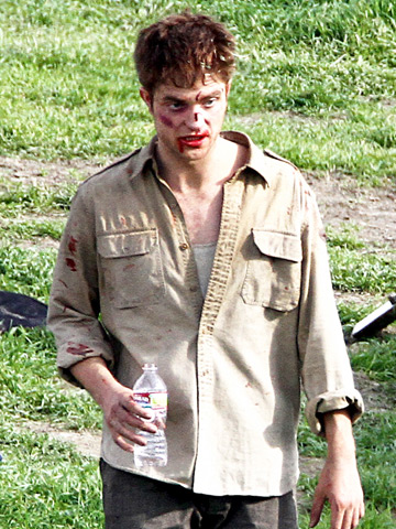 Robert Pattinson , looking a bit roughed-up for a scene in Water for Elephants .