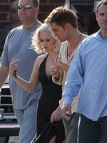 Reese Witherspoon joins costar Robert Pattinson in this peek at the set of Water For Elephants .