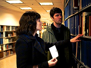 BROWSING STACKS Trieste Kelly Dunn and Cris Lankenau play detectives in Cold Weather