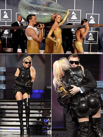 Entering the ceremony by embryonic egg was one thing, but accepting her trophy in a Batgirl suit was a new level of, well, gaga.