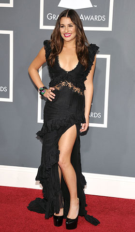 Lea Michele | She may have gone the more conventional route on the red carpet, but the Glee star still nodded to the night by forgoing her usual…
