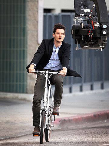 Orlando Bloom takes a ride while filming The Good Doctor .