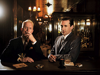 Jon Hamm, John Slattery, ... | WHO ARE YOU? Roger Sterling (John Slattery) and Don Draper (Jon Hamm) in Mad Men