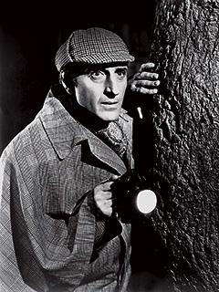 Basil Rathbone, The Hound of the Baskervilles   FAMOUS DETECTIVE Basil Rathbone as Sherlock Holmes in The Hound of the Baskervilles