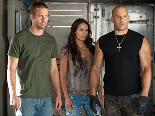 FIFTH TIME'S A CHARM Paul Walker, Jordana Brewster, and Vin Diesel in Fast Five