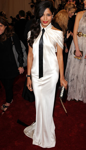 Freida Pinto | The white gown says feminine, the skinny black tie says masculine, and together they say all wrong. F+