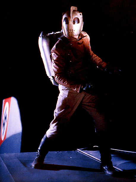 The Rocketeer | Darren: The jacket is so cool. The whole outfit is so sleek. But I'm unsure about that mask. It kind of cuts off his neck.…