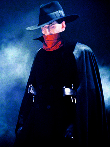The Shadow, Alec Baldwin | Darren: This could've looked cool, with the red-and-black look, but the hat is way too big, and the cape just doesn't sit well on Alec…