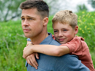 LIKE FATHER, LIKE SON? Brad Pitt and Laramie Eppler in The Tree of Life