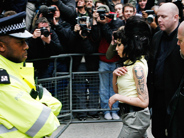 Police investigated accusations that Winehouse headbutted a man outside of a bar who tried to hail her a taxi. The Sun claimed it was her…