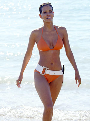 Halle Berry, Die Another Day | Remember that throwback orange bikini? Yowza! Need we say more? Actually, we do, for Berry's Jinx was the rare Bond babe whose wits in every…