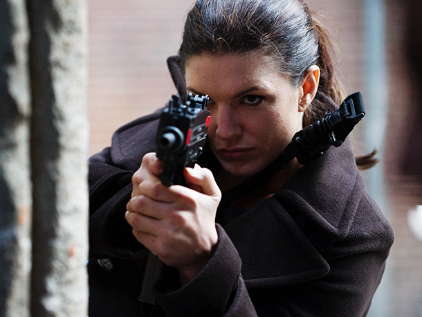 Fast on the heels of Contagion , director Steven Soderbergh unleashes a thriller starring real-life mixed martial artist Gina Carano as a former black-ops soldier…