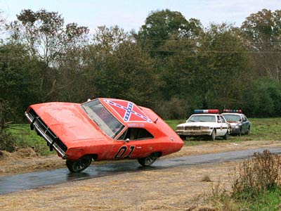 The Dukes of Hazzard (Movie - 2005) | We'll forgive ''that flag'' that's on the roof; nothing ever jumped over creeks and riverbeds and drifted around dirt roads like that crazy-orange Dodge Charger.…