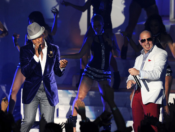 PITBULL AND NE-YO Did Pitbull and Ne-Yo get sucked into Tron ? With green lasers shooting all around them as if they were being hunted…
